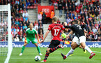 SOUTHAMPTON, ENGLAND - AUGUST 12: Stuart Armstrong of Southampton FC  (middle)  takes on Joe Hart (left) of Bunrley during the Premier League match between Southampton FC and Burnley FC at St Mary's Stadium on August 12, 2018 in Southampton, United Kingdom. (Photo by James Bridle - Southampton FC/Southampton FC via Getty Images)