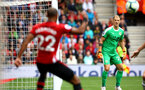 SOUTHAMPTON, ENGLAND - AUGUST 12: Nathan Redmond (left) of Southampton FC crosses the ball in  as Burnleys Joe Hart (Right) looks on during the Premier League match between Southampton FC and Burnley FC at St Mary's Stadium on August 12, 2018 in Southampton, United Kingdom. (Photo by James Bridle - Southampton FC/Southampton FC via Getty Images)
