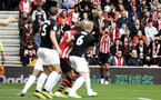 SOUTHAMPTON, ENGLAND - AUGUST 12: Jack Stephens (right) of Southampton FC makes a throw in during the Premier League match between Southampton FC and Burnley FC at St Mary's Stadium on August 12, 2018 in Southampton, United Kingdom. (Photo by James Bridle - Southampton FC/Southampton FC via Getty Images)