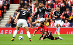 SOUTHAMPTON, ENGLAND - AUGUST 12: Charlie Austin of Southampton FC goes down (right) during the Premier League match between Southampton FC and Burnley FC at St Mary's Stadium on August 12, 2018 in Southampton, United Kingdom. (Photo by James Bridle - Southampton FC/Southampton FC via Getty Images)