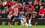 SOUTHAMPTON, ENGLAND - AUGUST 12: LtoR Cedric, Mario Lemina contest a refree decision during the Premier League match between Southampton FC and Burnley FC at St Mary's Stadium on August 12, 2018 in Southampton, United Kingdom. (Photo by James Bridle - Southampton FC/Southampton FC via Getty Images)
