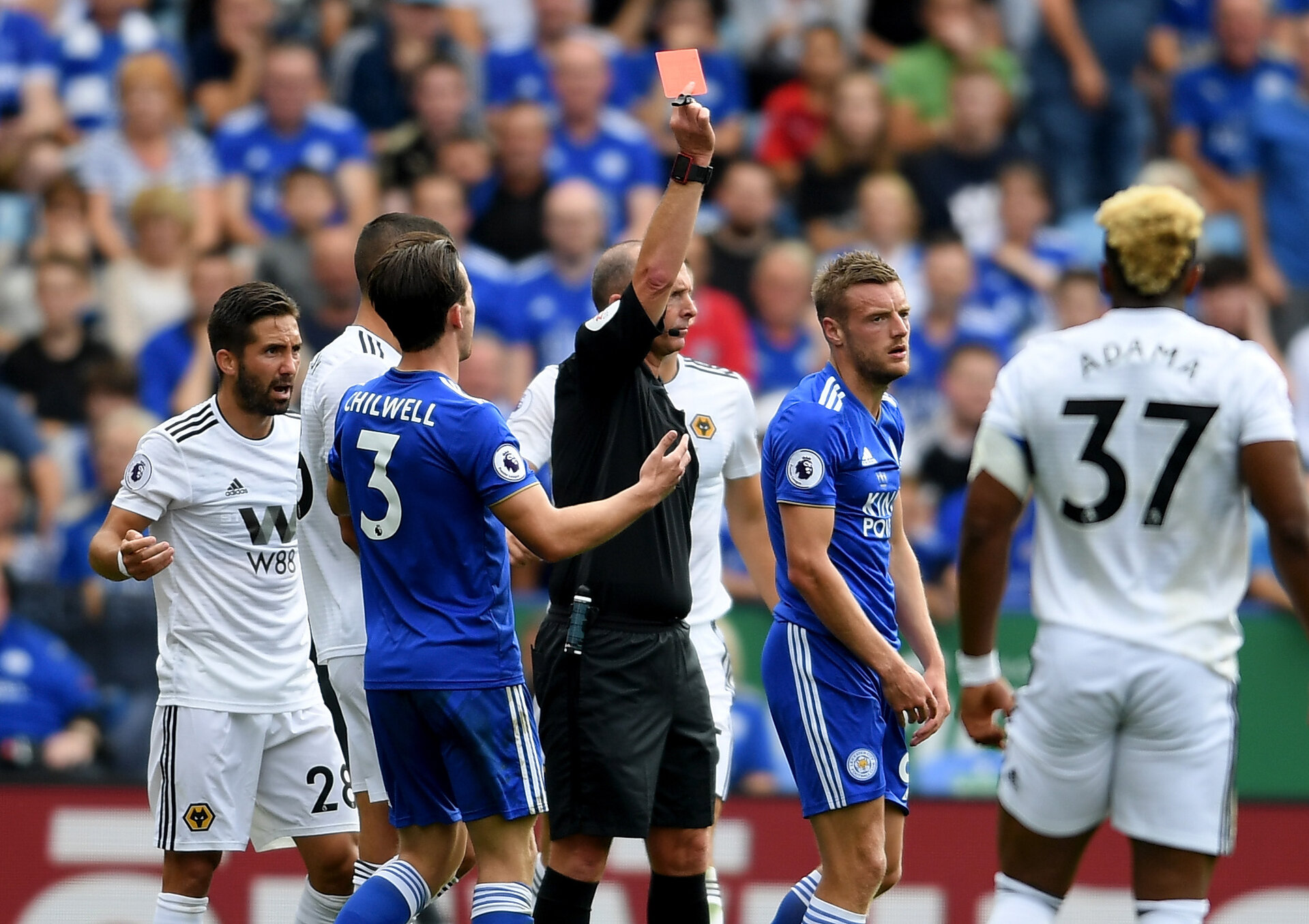 LEICESTER, ENGLAND - AUGUST 18:  Jamie Vardy of Leicester City is sent off by referee Mike Dean during the Premier League match between Leicester City and Wolverhampton Wanderers at The King Power Stadium on August 18, 2018 in Leicester, United Kingdom.  (Photo by Ross Kinnaird/Getty Images)