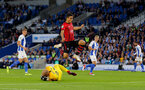 BRIGHTON, ENGLAND - AUGUST 28: Mohamed Elyounoussi of Southampton hurdles Brighton goalkeeper David Button during the Carabao Cup Second Round match between Brighton & Hove Albion and Southampton at American Express Community Stadium on August 28, 2018 in Brighton, England. (Photo by Matt Watson/Southampton FC via Getty Images)