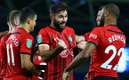 BRIGHTON, ENGLAND - AUGUST 28: LtoR Charlie Austin celebrates with Nathan Redmond during the Carabao Cup Second Round match between Brighton & Hove Albion and Southampton at American Express Community Stadium on August 28, 2018 in Brighton, England. (Photo by James Bridle - Southampton FC/Southampton FC via Getty Images)