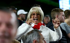 BRIGHTON, ENGLAND - AUGUST 28: Southampton FC fan celebrates during the Carabao Cup Second Round match between Brighton & Hove Albion and Southampton at American Express Community Stadium on August 28, 2018 in Brighton, England. (Photo by James Bridle - Southampton FC/Southampton FC via Getty Images)