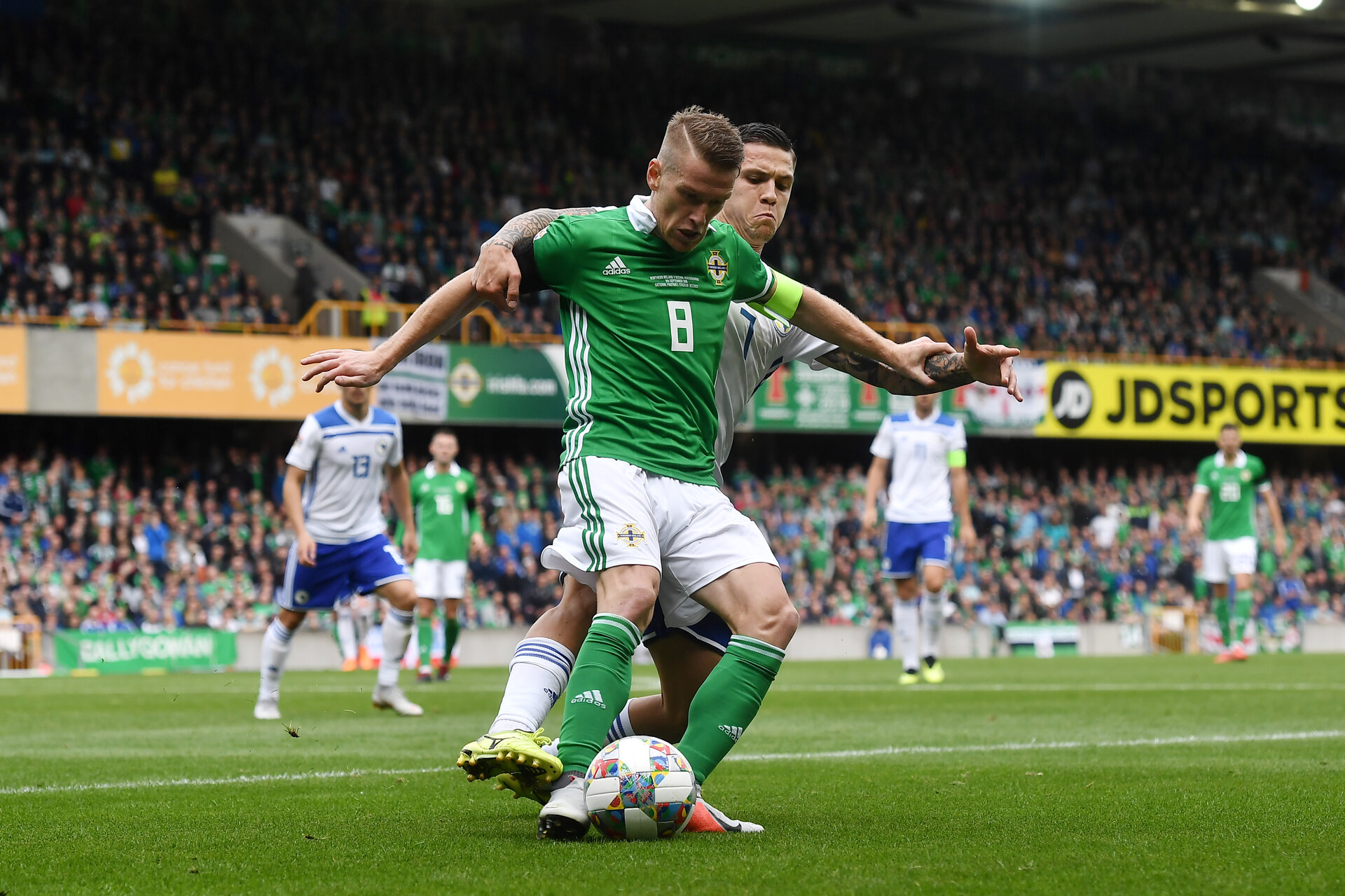 BELFAST, NORTHERN IRELAND - SEPTEMBER 08: Steve Davis of Northern Ireland and Muhamed Besic of Bosnia-Herzegovina during the UEFA Nations League B group three match between Northern Ireland and Bosnia-Herzegovina at Windsor Park on September 8, 2018 in Belfast, Northern Ireland. (Photo by Charles McQuillan/Getty Images)