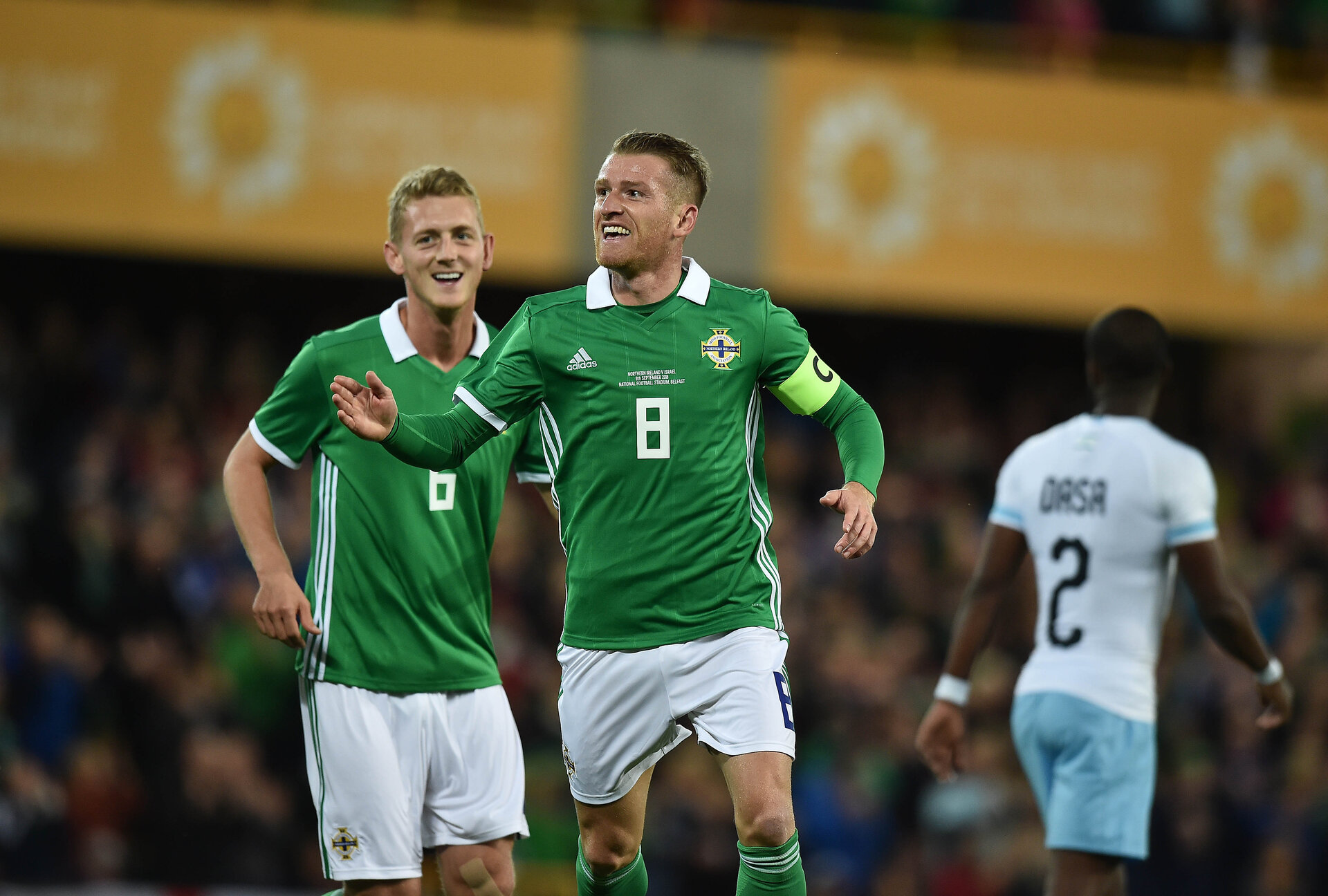 BELFAST, NORTHERN IRELAND - SEPTEMBER 11: Steve Davis of Northern Ireland celebrates with team mates after scoring during the international friendly football match between Northern Ireland and Israel at Windsor Park on September 11, 2018 in Belfast, Northern Ireland. (Photo by Charles McQuillan/Getty Images)