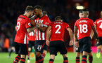 SOUTHAMPTON, ENGLAND - SEPTEMBER 17: LtoR Danny Ings, Ryan Bertrand, Cedric, Mario Lemina of Southampton FC after Danny Ings scores from the penalty spot during the Premier League match between Southampton FC and Brighton & Hove Albion at St Mary's Stadium on September 17, 2018 in Southampton, United Kingdom. (Photo by James Bridle - Southampton FC/Southampton FC via Getty Images)
