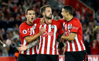 SOUTHAMPTON, ENGLAND - SEPTEMBER 17: LtoR Cedric, Danny Ings, Mohamed Elyounoussi during a celebration after Danny Ings scores for the Premier League match between Southampton FC and Brighton & Hove Albion at St Mary's Stadium on September 17, 2018 in Southampton, United Kingdom. (Photo by James Bridle - Southampton FC/Southampton FC via Getty Images)