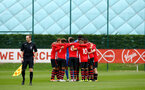 SOUTHAMPTON, ENGLAND - SEPTEMBER 22: Team huddle ahead of KO for the U18 Premier League match between Southampton FC and Brighton Hove Albion at Staplewood Training Ground on September 22, 2018 in Southampton, United Kingdom. (Photo by James Bridle - Southampton FC/Southampton FC via Getty Images)