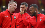 LIVERPOOL, ENGLAND - SEPTEMBER 22: L to R Matt Targett, Charlie Austin and Ryan Bertrand of Southampton during the Premier League match between Liverpool FC and Southampton FC at Anfield on September 22, 2018 in Liverpool, United Kingdom. (Photo by Matt Watson/Southampton FC via Getty Images)