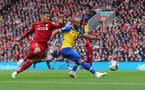 LIVERPOOL, ENGLAND - SEPTEMBER 22: Nathan Redmond(R) of Southampton and Roberto Firmino(L) during the Premier League match between Liverpool FC and Southampton FC at Anfield on September 22, 2018 in Liverpool, United Kingdom. (Photo by Matt Watson/Southampton FC via Getty Images)