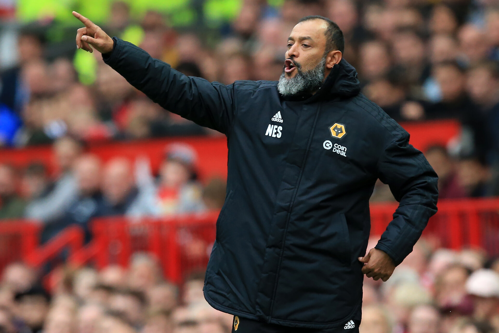 Wolverhampton Wanderers' Portuguese head coach Nuno Espirito Santo gestures on the touchline during the English Premier League football match between Manchester United and Wolverhampton Wanderers at Old Trafford in Manchester, north west England, on September 22, 2018. (Photo by Lindsey PARNABY / AFP) / RESTRICTED TO EDITORIAL USE. No use with unauthorized audio, video, data, fixture lists, club/league logos or 'live' services. Online in-match use limited to 120 images. An additional 40 images may be used in extra time. No video emulation. Social media in-match use limited to 120 images. An additional 40 images may be used in extra time. No use in betting publications, games or single club/league/player publications. /         (Photo credit should read LINDSEY PARNABY/AFP/Getty Images)