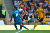 Saints beaten by Wolves late show