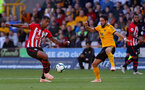 WOLVERHAMPTON, ENGLAND - SEPTEMBER 29: Mario Lemina(L) of Southampton and Joao Moutinho(R) of Wolves during the Premier League match between Wolverhampton Wanderers and Southampton FC at Molineux on September 29, 2018 in Wolverhampton, United Kingdom. (Photo by Matt Watson/Southampton FC via Getty Images)
