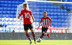 SOUTHAMPTON, ENGLAND - SEPTEMBER 29: Callum Slattery (right) during a PL2 U23s match where Reading FC play Southampton FC at Madjeski Stadium on September 29, 2018 in Reading, England. (Photo by James Bridle - Southampton FC/Southampton FC via Getty Images)