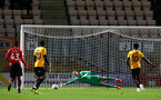 CAMBRIDGE, ENGLAND - OCTOBER 09: Harry Lewis (middle) of Southampton FC during a penalty which results in a goal for Cambridge United during the U21s Checkatade Trophy between Cambridge United and Southampton FC pictured at Abbey Stadium on October 9, 2018 in Cambridge, England. (Photo by James Bridle - Southampton FC/Southampton FC via Getty Images)