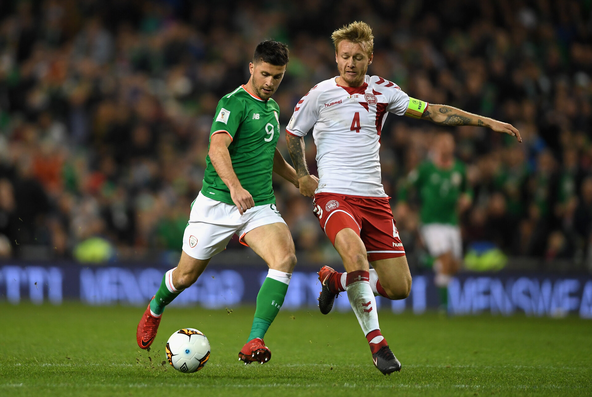 DUBLIN, IRELAND - NOVEMBER 14: Shane Long of the Republic of Ireland and Simon Kjaer of Denmark battle for possession during the FIFA 2018 World Cup Qualifier Play-Off: Second Leg between Republic of Ireland and Denmark at Aviva Stadium on November 14, 2017 in Dublin, Ireland.  (Photo by Mike Hewitt/Getty Images)