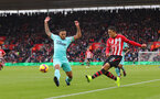 SOUTHAMPTON, ENGLAND - OCTOBER 27: Mohamed Elyounoussi(R) of Southampton crosses ahead of Jamaal Lascelles of Newcastle during the Premier League match between Southampton FC and Newcastle United at St Mary's Stadium on October 27, 2018 in Southampton, United Kingdom. (Photo by Matt Watson/Southampton FC via Getty Images)
