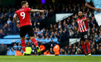 MANCHESTER, ENGLAND - NOVEMBER 04: Danny Ings of Southampton scores from the penalty spot during the Premier League match between Manchester City and Southampton FC at Etihad Stadium on November 4, 2018 in Manchester, United Kingdom. (Photo by Matt Watson/Southampton FC via Getty Images)