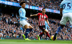 MANCHESTER, ENGLAND - NOVEMBER 04: Cedric(centre) and Leroy Sane(L) of Southampton during the Premier League match between Manchester City and Southampton FC at Etihad Stadium on November 4, 2018 in Manchester, United Kingdom. (Photo by Matt Watson/Southampton FC via Getty Images)