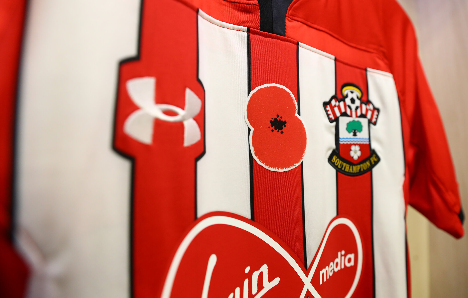 SOUTHAMPTON, ENGLAND - NOVEMBER 10: Southampton FC shirts geaturing a remembrance poppy, inside the dressing room of Southampton ahead of the Premier League match between Southampton FC and Watford FC at St Mary's Stadium on November 10, 2018 in Southampton, United Kingdom. (Photo by Matt Watson/Southampton FC via Getty Images)