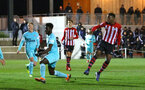SOUTHAMPTON, ENGLAND - DECEMBER 14: Jonathan Afolabi shoots and scores (right) during the U23s PL2 match between Southampton FC and Newcastle United pictured at Staplewood Training Ground on December 14, 2018 in Southampton England. (Photo by James Bridle - Southampton FC/Southampton FC via Getty Images)