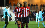 SOUTHAMPTON, ENGLAND - DECEMBER 14: Jonathan Afolabi (middle) scores and celebrates during the U23s PL2 match between Southampton FC and Newcastle United pictured at Staplewood Training Ground on December 14, 2018 in Southampton England. (Photo by James Bridle - Southampton FC/Southampton FC via Getty Images)