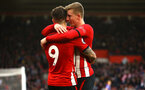 SOUTHAMPTON, ENGLAND - DECEMBER 16: Matt Target hugs Danny Ings after Danny scores Southampton FC  fans ahead of the Premier League match between Southampton FC and Arsenal FC at St Mary's Stadium on December 16, 2018 in Southampton, United Kingdom. (Photo by James Bridle - Southampton FC/Southampton FC via Getty Images)