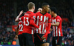 SOUTHAMPTON, ENGLAND - DECEMBER 16: Danny Ings scores and celebrates with Matt Target, Yan Valery during the Premier League match between Southampton FC and Arsenal FC at St Mary's Stadium on December 16, 2018 in Southampton, United Kingdom. (Photo by James Bridle - Southampton FC/Southampton FC via Getty Images)
