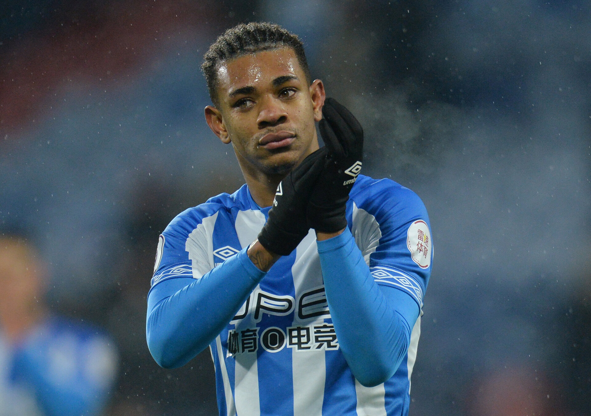 """Soccer Football - Premier League - Huddersfield Town v Newcastle United - John Smith's Stadium, Huddersfield, Britain - December 15, 2018  Huddersfield Town's Juninho Bacuna applauds fans after the match          REUTERS/Peter Powell  EDITORIAL USE ONLY. No use with unauthorized audio, video, data, fixture lists, club/league logos or """"live"""" services. Online in-match use limited to 75 images, no video emulation. No use in betting, games or single club/league/player publications.  Please contact your account representative for further details."""