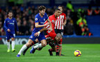 LONDON, ENGLAND - JANUARY 02: Oriol Romeu(R) of Southampton and Marcos Alonso of Chelsea during the Premier League match between Chelsea FC and Southampton FC at Stamford Bridge on January 02, 2019 in London, United Kingdom. (Photo by Matt Watson/Southampton FC via Getty Images)