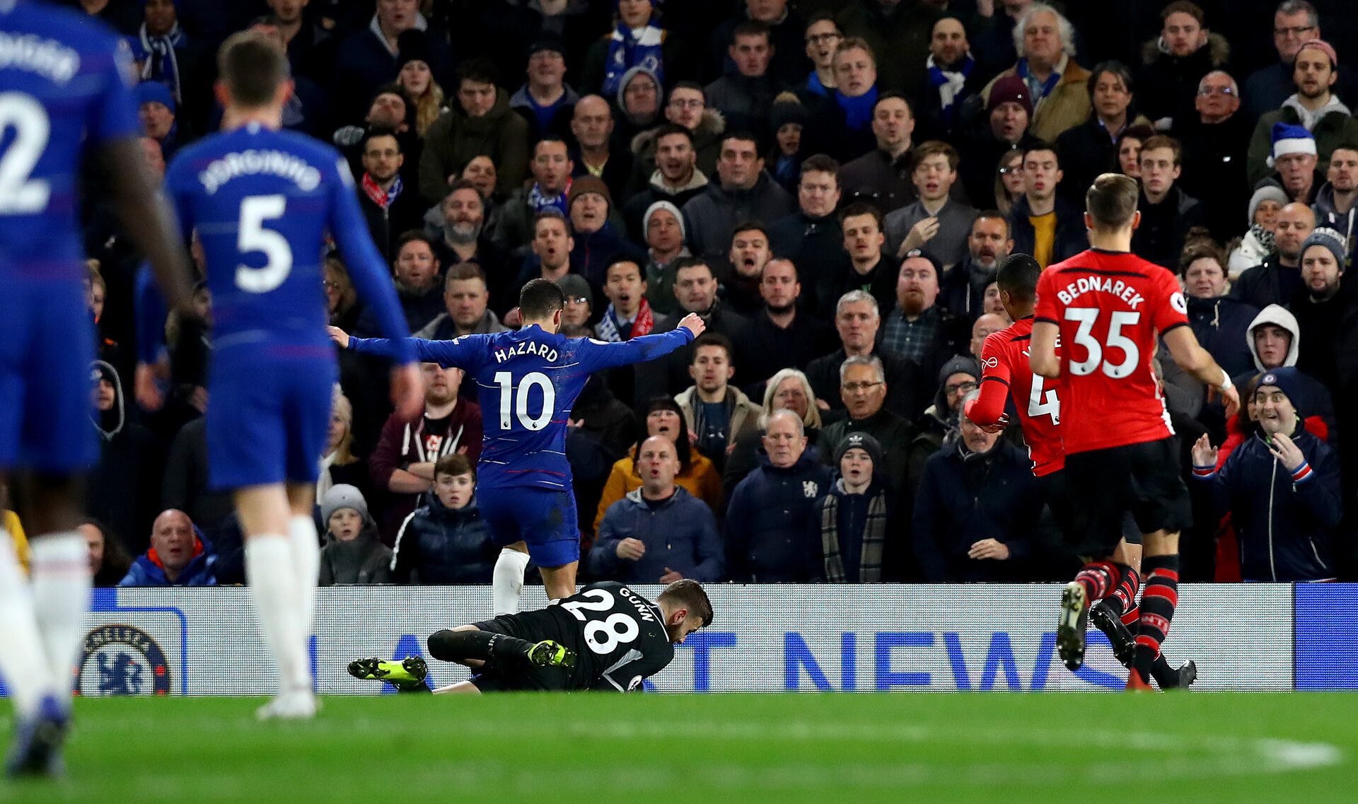 LONDON, ENGLAND - JANUARY 02: Angus Gunn of Southampton saves from Eden Hazard of Chelsea during the Premier League match between Chelsea FC and Southampton FC at Stamford Bridge on January 02, 2019 in London, United Kingdom. (Photo by Matt Watson/Southampton FC via Getty Images)
