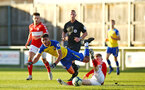 MIDDLESBROUGH, ENGLAND - JANUARY 13:  Marcus Barnes is challenged (left) during the Premier League 2 match between Middlesbrough FC and Southampton FC at Heritage Park on January 13, 2019 in Middlesbrough, United Kingdom. (Photo by James Bridle - Southampton FC/Southampton FC via Getty Images)