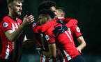 LEEDS, ENGLAND - JANUARY 21:  Marcus Barnes scores and is hugged by team mates Oludare Olufunwa (middle) during the PL CUP match between Leeds United vs Southampton FC on January 21, 2019 in Watford, United Kingdom. (Photo by James Bridle - Southampton FC/Southampton FC via Getty Images)