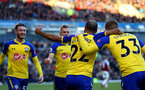 BURNLEY, ENGLAND - FEBRUARY 02: Players of Southampton celebrate with Nathan Redmond after he opens the scoring during the Premier League match between Burnley FC and Southampton FC at Turf Moor on February 02, 2019 in Burnley, United Kingdom. (Photo by Matt Watson/Southampton FC via Getty Images)