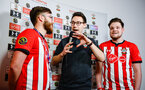 SOUTHAMPTON, ENGLAND - FEBRUARY 14: LtoR Finalists Mplccieneill18 (left) Venn (right) speaks with Tom Deacon (middle) during the ePremier League tournament held at St Mary's Stadium on February 14, 2019 in Southampton, England. (Photo by James Bridle - Southampton FC/Southampton FC via Getty Images)