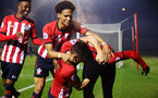 SOUTHAMPTON, ENGLAND - FEBRUARY 15: Jonathan Afolabi   scores and celebrates with team mates, Oludare Olufunwa, Nathan Tella, Harry Hamblin during the U23s PL2 match between Southampton FC and Fulham FC pictured at Staplewood Complex on February 15, 2019 in Southampton, England. (Photo by James Bridle - Southampton FC/Southampton FC via Getty Images)