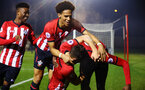 SOUTHAMPTON, ENGLAND - FEBRUARY 15: Jonathan Afolabi (right) scores for Southampton FC and celebrates with his team mates Harry Hamblin, Oludare Olufunwa, Nathan Tella during the U23s PL2 match between Southampton FC and Fulham FC pictured at Staplewood Complex on February 15, 2019 in Southampton, England. (Photo by James Bridle - Southampton FC/Southampton FC via Getty Images)