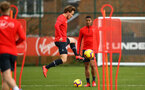SOUTHAMPTON, ENGLAND - FEBRUARY 20: Jake Vokins (left)  incepts a ball in front of Yan Valery (middle) during a Southampton FC training session pictured at Staplewood Complex on February 20, 2019 in Southampton, England. (Photo by James Bridle - Southampton FC/Southampton FC via Getty Images)