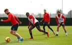 SOUTHAMPTON, ENGLAND - FEBRUARY 20: Michael Obafemi (middle) Josh Sims (left) Charlie Austin (right) during a Southampton FC training session pictured at Staplewood Complex on February 20, 2019 in Southampton, England. (Photo by James Bridle - Southampton FC/Southampton FC via Getty Images)