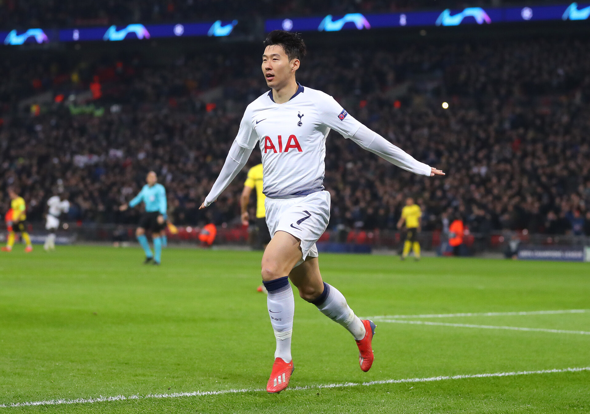 LONDON, ENGLAND - FEBRUARY 13: Son Heung-Min of Tottenham celebrates scoring to make it 1-0 during the UEFA Champions League Round of 16 First Leg match between Tottenham Hotspur and Borussia Dortmund at Wembley Stadium on February 13, 2019 in London, England. (Photo by Catherine Ivill/Getty Images)