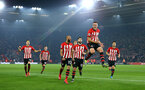 SOUTHAMPTON, ENGLAND - FEBRUARY 27:  Oriol Romeu of Southampton FC scores and celebrates (middle) with Nathan Redmond, Charlie Austin, Maya Yoshida during the Premier League match between Southampton FC and Fulham FC at St Mary's Stadium on February 27, 2019 in Southampton, United Kingdom. (Photo by James Bridle - Southampton FC/Southampton FC via Getty Images)