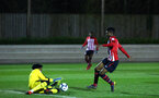 SOUTHAMPTON, ENGLAND - MARCH 01: Nathan Tella (right) challenges the goal keeper (during the PL2 match between Southampton FC and Reading FC pictured at Staplewood Complex on March 01, 2019 in Southampton, England. (Photo by James Bridle - Southampton FC/Southampton FC via Getty Images)