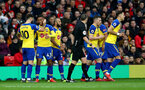MANCHESTER, ENGLAND - MARCH 02: Yan Valery is congratulated by team mates after scoring during the Premier League match between Manchester United and Southampton FC at Old Trafford on March 02, 2019 in Manchester, United Kingdom. (Photo by Matt Watson/Southampton FC via Getty Images)
