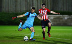 SOUTHAMPTON, ENGLAND - MARCH 06: Will Ferry (right) of Southampton FC challenges Villarreal GK JOAN FEMENÍAS (left) the during the U23's International Cup match between Southampton FC vs Villarreal pictured at Staplewood Complex on March 06, 2019 in Southampton, England. (Photo by James Bridle - Southampton FC/Southampton FC via Getty Images)