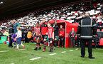 SOUTHAMPTON, ENGLAND - MARCH 09: Pierre-Emile Hojbjerg of Southampton leads the teams out with the match day mascots during the Premier League match between Southampton FC and Tottenham Hotspur at St Mary's Stadium on March 09, 2019 in Southampton, United Kingdom. (Photo by Matt Watson/Southampton FC via Getty Images)