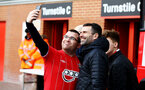 SOUTHAMPTON, ENGLAND - MARCH 09: Ex Player Francis Benali (right) with fans ahead of the Premier League match between Southampton FC and Tottenham Hotspur at St Mary's Stadium on March 09, 2019 in Southampton, United Kingdom. (Photo by James Bridle - Southampton FC/Southampton FC via Getty Images)