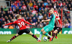 SOUTHAMPTON, ENGLAND - MARCH 09:  Josh Sims (left) takes on Erik Dier of Tottenham Hotspur (middle) during the Premier League match between Southampton FC and Tottenham Hotspur at St Mary's Stadium on March 09, 2019 in Southampton, United Kingdom. (Photo by James Bridle - Southampton FC/Southampton FC via Getty Images)