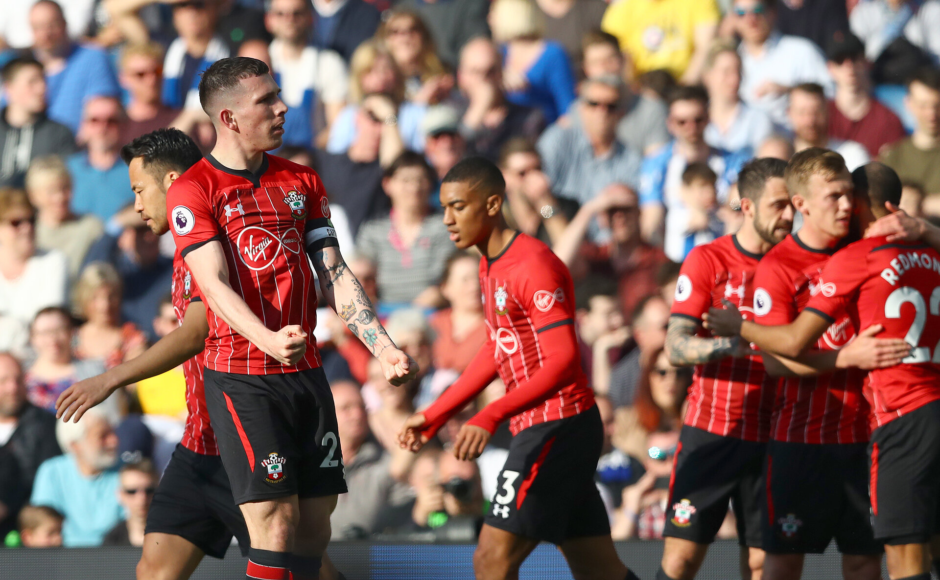 BRIGHTON, ENGLAND - MARCH 30: Pierre-Emile Hojbjerg of Southampton celebrates with his team mates after opening the scoring during the Premier League match between Brighton & Hove Albion and Southampton FC at American Express Community Stadium on March 30, 2019 in Brighton, United Kingdom. (Photo by Matt Watson/Southampton FC via Getty Images)